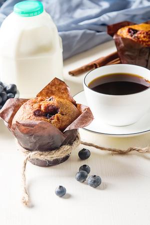 blueberry muffin: Blueberry muffins and fresh fruit, a cup of black coffee. Tasty dessert. Light breakfast. St. Valentines Day. Dark background