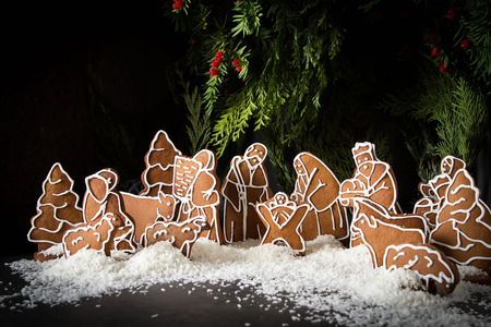 Christmas Betlem decoration, gingerbread. The Birth of Christ. Dark background