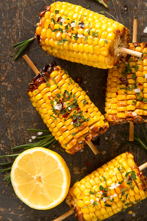 Corn grilled with salt and spices. Dark background. Fast food in the summer