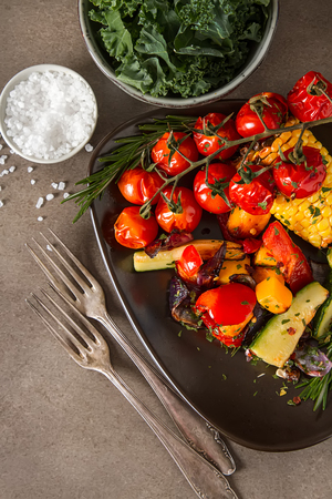 Grilled vegetables with salt and spices. Dark background. Fast food in the summer. A vegan picnic Zdjęcie Seryjne