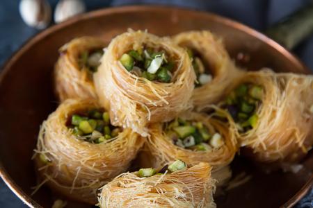 Traditional arabic dessert baklava with pistachios. Dark background