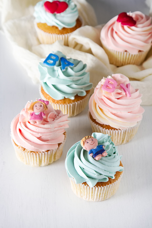 Birthday cupcake with pink and blue cream. White background