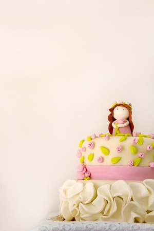 Cake for the girl on her birthday. Sweet gift. Feeling a holiday. Light background Stock Photo