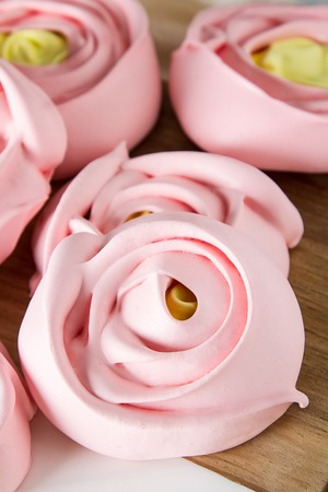meringue in the form of a pink flower. Light background