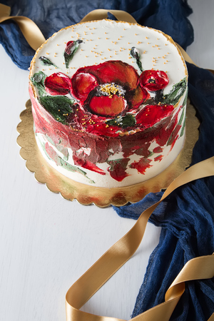 A cake for a holiday with flowers. Light background