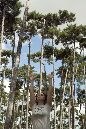 peacefull: Young woman with hands up, outdoors , in a parc