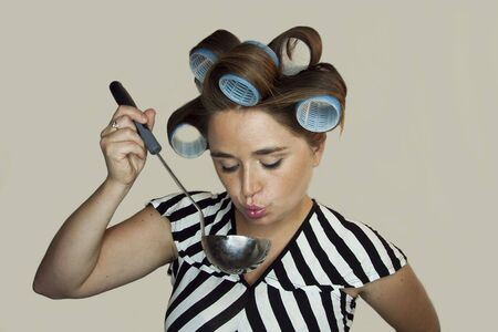 hot rollers: young woman with a ladle