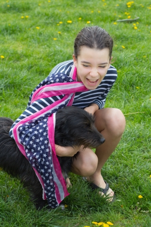 young girl with dog and American flag scarf photo