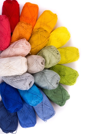 colors of yarn thread on white background Imagens