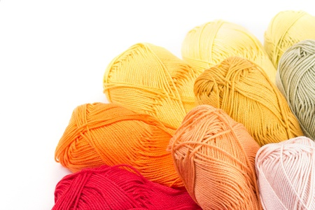 colors of yarn thread on white background photo