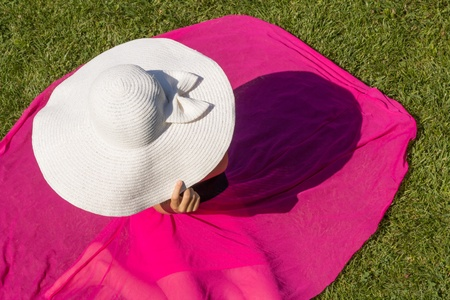 Young girl in white hat and sunglasses outdoor photo