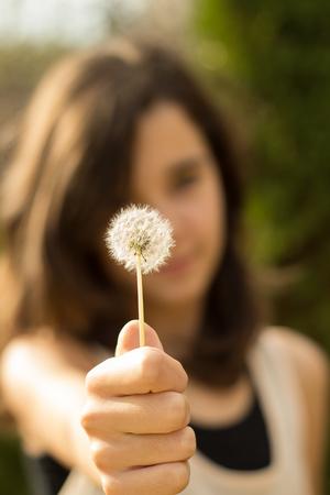 Girl with dandelion photo