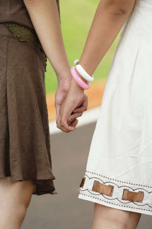 Image of two girls are holding hand. photo