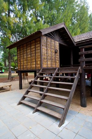 Traditional Thai House in the tropical rainforest. photo