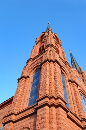 apostle paul: Low angle shot of the corner spire of St  Paul the Apostle Church in Calumet, Michigan   The red sandstone architecture was locally quaried in the Upper Peninsula area