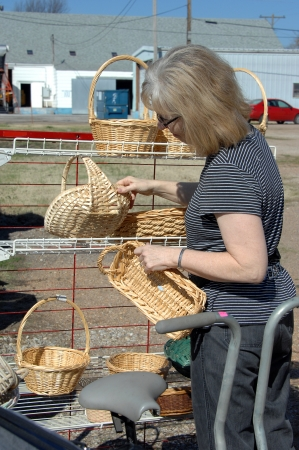 sales person: Garage saler, hunts through rack of wicker and ratan baskets for a bargain