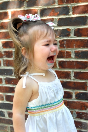 Little girl cries because things didn Stock Photo