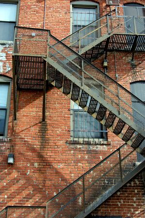 Fire escape winds back and forth down the side of an old brick apartment complex in downtown Wichita, Kansas