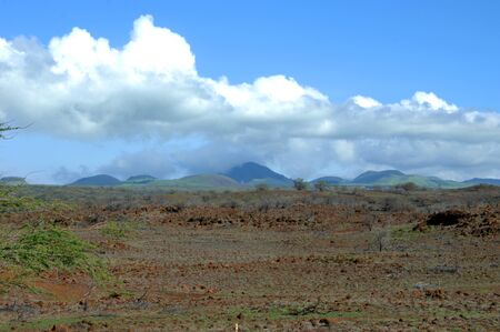 dormant: Big Island of Hawaii has many dormant cinder cones.  This group is covered by clouds. Stock Photo
