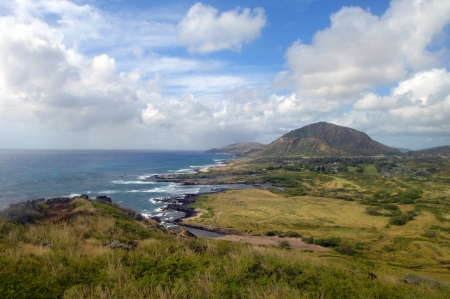 Makapuu Lighthouse Trail overlook has distant view of Diamond Head and the southern shores of Oahu, Hawaii. photo