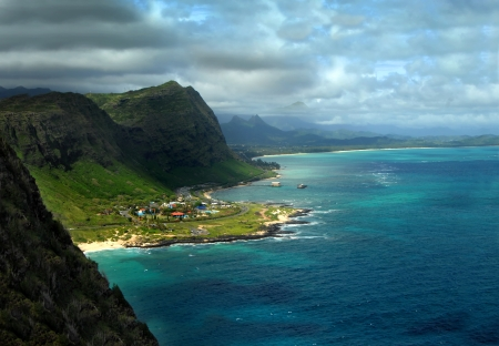 Overlook from the Makapuu Lighthouse Trail reveals dark clouds rolling in over the Tantalus Mountains on the Island of Oahu Hawaii.   photo