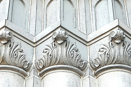 Abstract church pillars form rounded, pointed, and flat pattern in white and cream   Angles add depth and uniformity  photo