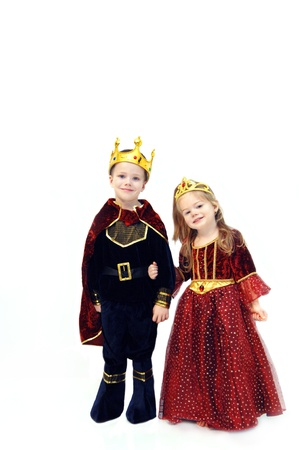 Little girl and boy are wearing Halloween costumes.  One is the King and the other a queen.  Costumes come complete with crowns.