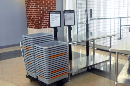 Storage bins are stacked and waiting for the gate to be unlocked and security checking begun at the Lynchburg, Virginia airport.