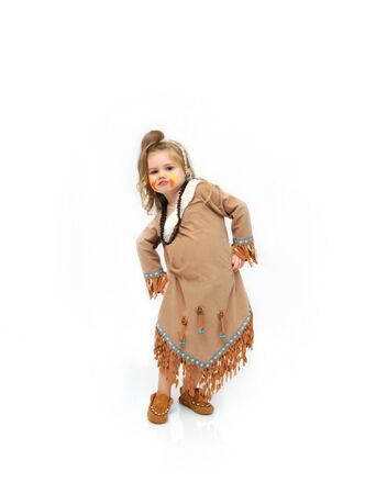 dressup: Adorable indian princess wearing fringed leather dress and moccasins, dances a rain dance or war dance.  Her face is comical and her hands are on her hips.  She is standing in an all white room.