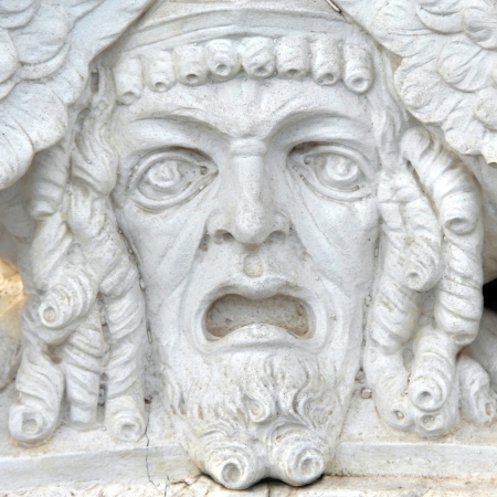 agony: Satue face reflects an agony of pain or defeat.  Mouth hangs open with eyes drooping.