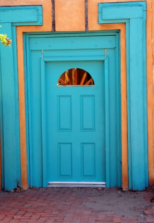 Turquoise doors abound in old town Albuquerque, New Mexico.  This door fronts the plaza of a home. photo