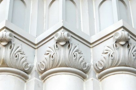 painted wood: Details of church building includes scroll work and intricate pattern of architecture.  Angles add depth and uniformity.