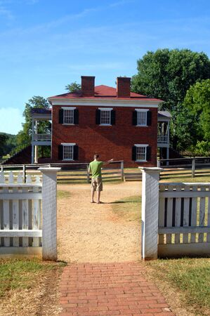 civil war: History buff explores the Appomatox County Courthouse National Historical Park in Virginia.  He is examining the map of the ground and pointing out his next exploration. Stock Photo