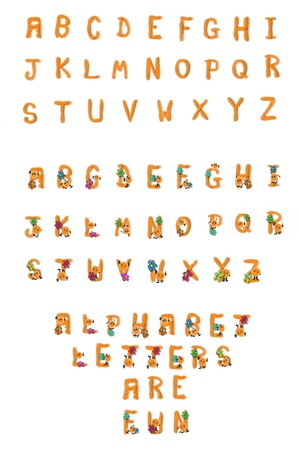 complete: Alphabet letters A to Z, in both upper and lower case, fill image.  Each letter is fuzzy chenille bent to form each letter of the alphabet.  The lower case letters are plain.  The upper case letters have a fuzzy man and wild colored flowers. Stock Photo