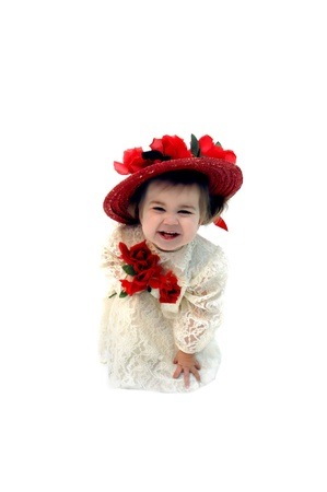 chuckling: Gorgeous little girl laughs hilariously and bends over double   She is dressed in an ivory lace dress, red straw hat with silk roses and is holding red silk roses