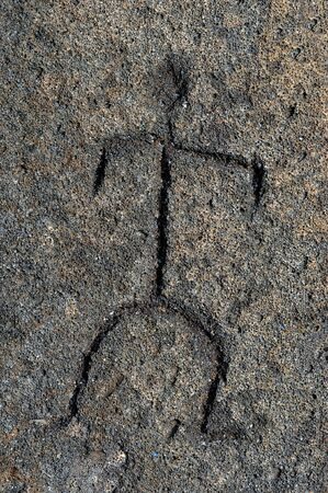 Art work of an early Hawaiian is preserved in this petroglyph found on the Big Island of Hawaii.  Drawing shows a man scratched in stone. photo