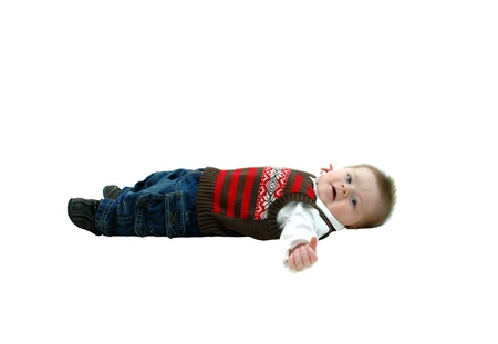 Sweet and contented baby lays on all white floor   He is cooing happily   Image is full length on white and isolated  Stock Photo - 14910383