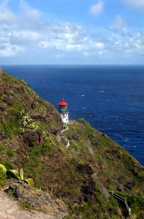 Overlook view of historic Makapuu Point Lighthouse and the azure waters of Makapuu Bay   Workers repair damage from erosion on the Island of Oahu, Hawaii