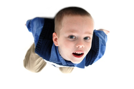 khakis: Small boy hangs from the ceiling   He is wearing khakis and navy blue sweater