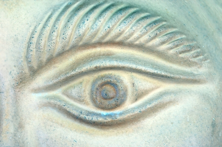 sightless: Stone eye is unblinking, never sleeping, always watching, sightless.  Tiny flecks of green tint picture with a tiny touch of color.