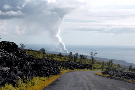 Smoke and vog billows out of the Kilauea vent as it empties into the ocean at Hawaii Volcanoes National Park on the Big Island