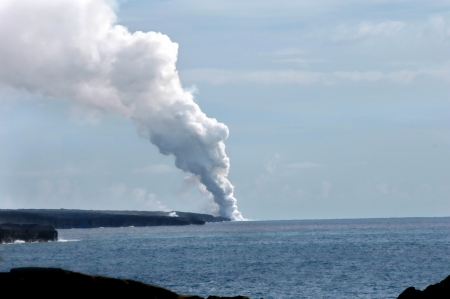 Kilauea Volcanoe continues to dump new lava into the ocean and onto the edge of the Big Island of Hawaii. Stock Photo - 15024177