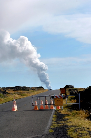 Sign warns visitors to the Hawaii Volcanoes National Park to stay behind gate.  Kilauea Volcanoe continues to produce vog and hazardous fumes. photo