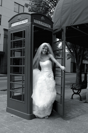 antique booth: Bride exits antique phone booth in downtown corner   She has made an emergency phone call