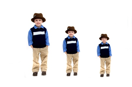 khakis: Little boy wearing a hat and khakis is represented in three sizes, small, medium and large   Images represent growth throughout childhood  Stock Photo