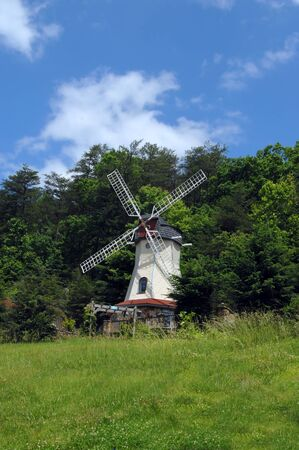 In the Appalachian mountains of Georgia, a small touristy town has been designed to look like an alpine village.  Helen, Georgia has a unique windmill situated on a hill as you enter the town. Stock Photo - 15056807