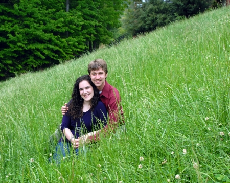 Field of green, on an Appalachian Mountain, serves as an enjoyable resting spot for this happy couple  photo