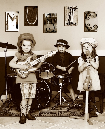 Three siblings pretend to be a music band   They are playing instruments and one is singing   The letters M, U, S, I, C is posted on the wall   Youngest member is singing  photo
