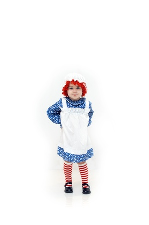 raggedy: Old fashioned Raggedy Ann style costume is worn by a cute little girl with a cute little smirk