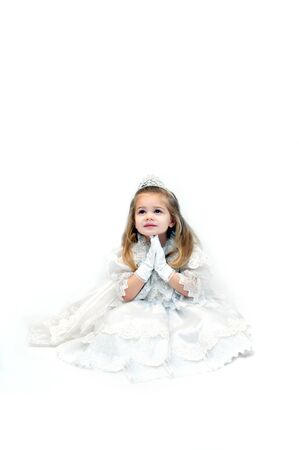 Little girl folds her hands in prayer Stock Photo - 15088726